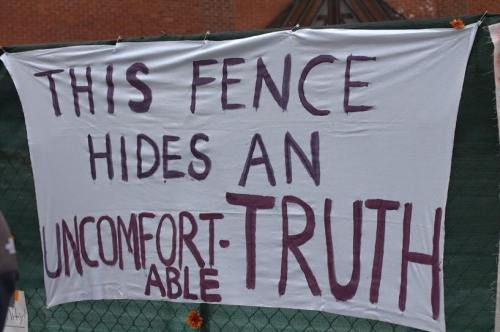 a sign on the construction fence around Crouse-Hinds, since removed