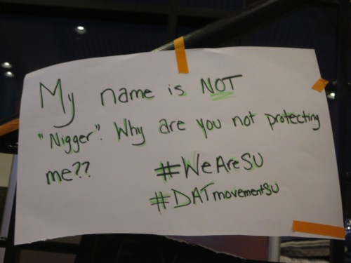 a student's sign protesting campus police discrimination, from the sit-in in Crouse-Hinds Hall